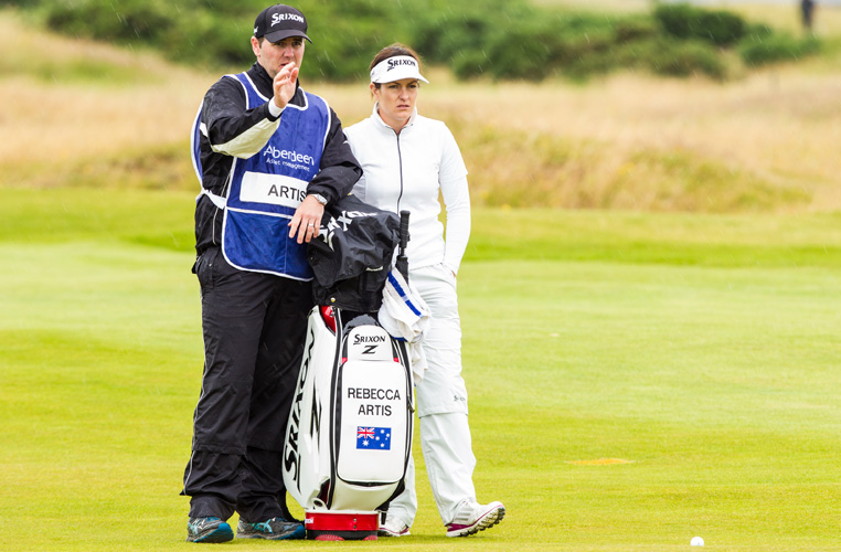 26/07/2015. Ladies European Tour 2015. Aberdeen Asset Management Ladies Scottish Open 2015, Dundonald Links, Irvine, Troon, Scotland. July 24-26. Rebecca Artis of Australia gets the line to the green from husband and caddie Geoff during the final round. Credit: Tristan Jones
