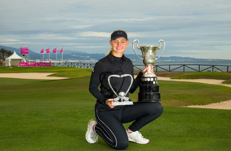 Emily Pedersen with the Open de Espana and Race to Costa del Sol trophies